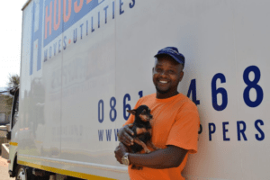HouseHoppers moving team member holding a puppy