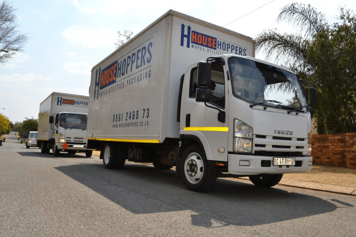 Two Househoppers moving trucks