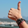 Thumbs up hand with bracelets